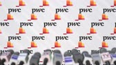 anúncio : Media event of PWC, press wall with logo and microphones, editorial animation Stock Footage