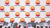 coverage : Press conference of PETROCHINA, press wall with logo and microphones, conceptual editorial animation Stock Footage