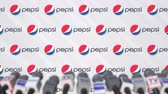 coverage : News conference of PEPSI, press wall with logo as a background and mics, editorial animation Stock Footage