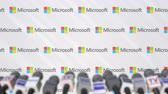 mike : News conference of MICROSOFT, press wall with logo as a background and mics, editorial animation Stock Footage