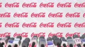 aviso : News conference of COCA-COLA company, press wall with logo as a background and mics, editorial animation