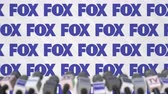 aviso : FOX company press conference, press wall with logo and mics, conceptual editorial animation