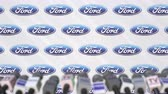 anúncio : News conference of FORD, press wall with logo as a background and mics, editorial animation Stock Footage