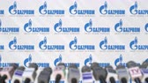 aviso : News conference of GAZPROM, press wall with logo as a background and mics, editorial animation