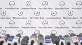 aviso : Press conference of MERCEDES-BENZ company, press wall with logo and microphones, conceptual editorial animation