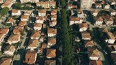çatılar : Aerial view of tiled dwelling houses in Rosignano Solvay. Tuscany, Italy Stok Video