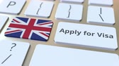 비자 : APPLY FOR VISA text and flag of Great Britain on the buttons on the computer keyboard. Conceptual 3D animation 무비클립