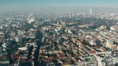çatılar : Aerial view of Castello Sforzesco castle and Sempione Park within cityscape of Milan, Italy Stok Video