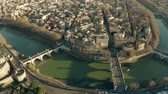 çatılar : Aerial view of the Tiber river, bridges and embankments near Castel SantAngelo castle. Rome, Italy Stok Video
