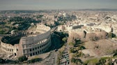 coliseum : Aerial view of Roman cityscape involving famous Colosseum amphitheatre, Italy Stock Footage