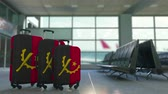 путешествие : Travel suitcases featuring flag of Angola. Angolan tourism conceptual animation
