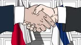 рукопожатие : Businessmen or politicians shake hands against flags of Poland and Finland. Official meeting or cooperation related cartoon animation