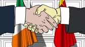 politiker : Businessmen or politicians shake hands against flags of Ireland and China. Official meeting or cooperation related cartoon animation