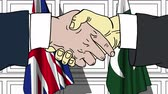 desenhado : Businessmen or politicians shake hands against flags of Great Britain and Pakistan. Official meeting or cooperation related cartoon animation Stock Footage