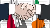 рукопожатие : Businessmen or politicians shake hands against flags of Poland and Ireland. Official meeting or cooperation related cartoon animation