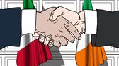 politiker : Businessmen or politicians shake hands against flags of Italy and Ireland. Official meeting or cooperation related cartoon animation Stock Footage