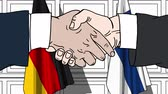 рукопожатие : Businessmen or politicians shake hands against flags of Germany and Finland. Official meeting or cooperation related cartoon animation Стоковые видеозаписи