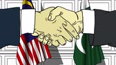 рукопожатие : Businessmen or politicians shake hands against flags of Malaysia and Pakistan. Official meeting or cooperation related cartoon animation