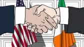 рукопожатие : Businessmen or politicians shake hands against flags of USA and Ireland. Official meeting or cooperation related cartoon animation