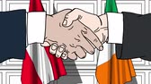 рукопожатие : Businessmen or politicians shake hands against flags of Austria and Ireland. Official meeting or cooperation related cartoon animation