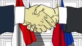 рукопожатие : Businessmen or politicians shake hands against flags of Indonesia and Philippines. Official meeting or cooperation related cartoon animation