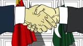 рукопожатие : Businessmen or politicians shake hands against flags of China and Pakistan. Official meeting or cooperation related cartoon animation