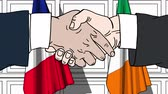 рукопожатие : Businessmen or politicians shake hands against flags of France and Ireland. Official meeting or cooperation related cartoon animation