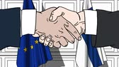diplomat : Businessmen or politicians shake hands against flags of the European Union EU and Finland. Official meeting or cooperation related cartoon animation