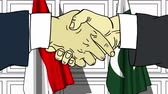 рукопожатие : Businessmen or politicians shake hands against flags of Indonesia and Pakistan. Official meeting or cooperation related cartoon animation