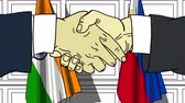 politiker : Businessmen or politicians shake hands against flags of India and Philippines. Official meeting or cooperation related cartoon animation