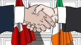 diplomat : Businessmen or politicians shake hands against flags of Switzerland and Ireland. Official meeting or cooperation related cartoon animation