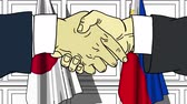 рукопожатие : Businessmen or politicians shake hands against flags of Japan and Philippines. Official meeting or cooperation related cartoon animation