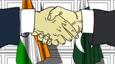 рукопожатие : Businessmen or politicians shake hands against flags of India and Pakistan. Official meeting or cooperation related cartoon animation