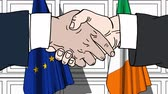 politiker : Businessmen or politicians shake hands against flags of the EU and Ireland. Official meeting or cooperation related cartoon animation