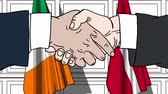 рукопожатие : Businessmen or politicians shake hands against flags of Ireland and Denmark. Official meeting or cooperation related cartoon animation