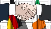 politiker : Businessmen or politicians shake hands against flags of Germany and Ireland. Official meeting or cooperation related cartoon animation