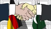pakistan : Businessmen or politicians shake hands against flags of Germany and Pakistan. Official meeting or cooperation related cartoon animation