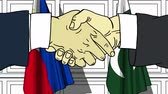 рукопожатие : Businessmen or politicians shake hands against flags of Philippines and Pakistan. Official meeting or cooperation related cartoon animation Стоковые видеозаписи