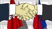рукопожатие : Businessmen or politicians shake hands against flags of Hong Kong and Philippines. Official meeting or cooperation related cartoon animation Стоковые видеозаписи