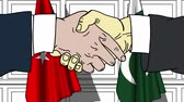 рукопожатие : Businessmen or politicians shake hands against flags of Turkey and Pakistan. Official meeting or cooperation related cartoon animation