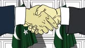 рукопожатие : Businessmen or politicians shake hands against flags of Pakistan. Official meeting or cooperation related cartoon animation Стоковые видеозаписи
