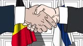 politiker : Businessmen or politicians shake hands against flags of Belgium and Finland. Official meeting or cooperation related cartoon animation Stock Footage