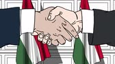 komiks : Businessmen or politicians shake hands against flags of Hungary. Official meeting or cooperation related cartoon animation