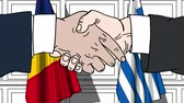рукопожатие : Businessmen or politicians shake hands against flags of Romania and Greece. Official meeting or cooperation related cartoon animation Стоковые видеозаписи