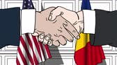 autorità : Businessmen or politicians shake hands against flags of the USA and Romania. Official meeting or cooperation related cartoon animation Filmati Stock