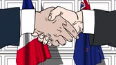 рукопожатие : Businessmen or politicians shake hands against flags of France and New Zealand. Official meeting or cooperation related cartoon animation Стоковые видеозаписи