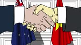 рукопожатие : Businessmen or politicians shake hands against flags of Australia and Vietnam. Official meeting or cooperation related cartoon animation