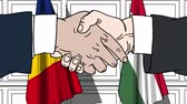 hungria bandera : Businessmen or politicians shake hands against flags of Romania and Hungary. Official meeting or cooperation related cartoon animation Archivo de Video