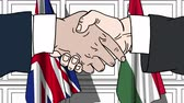 hungria bandera : Businessmen or politicians shake hands against flags of Great Britain and Hungary. Official meeting or cooperation related cartoon animation Archivo de Video