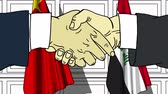 politiker : Businessmen or politicians shake hands against flags of China and Iraq. Official meeting or cooperation related cartoon animation Stock Footage